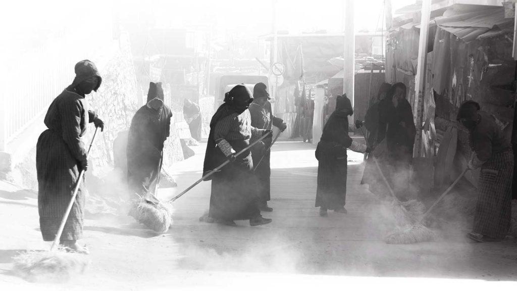 Tibetan cleaning floors